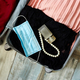 Packing suitcase at home with woman items, accessories - PhotoDune Item for Sale