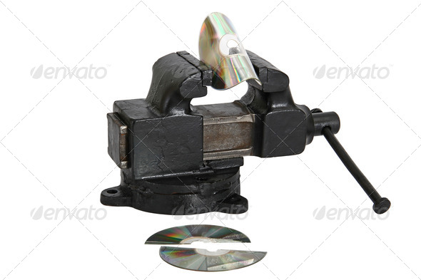 cd disk in vise - Stock Photo - Images