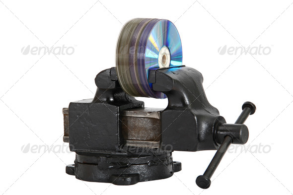 cd disks in vise - Stock Photo - Images