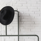 Black and white hat on hanger. White brick wall - PhotoDune Item for Sale