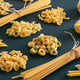 Pasta assortment on black background, closeup view. Cooking italian cuisine concept - PhotoDune Item for Sale
