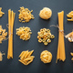Pasta assortment on black background, top view. Cooking italian cuisine concept - PhotoDune Item for Sale