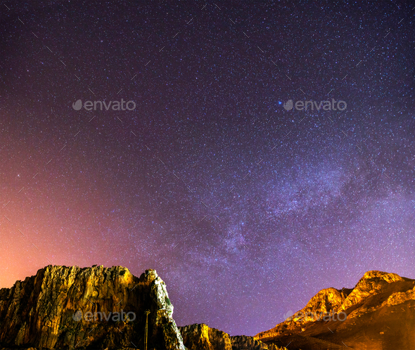 The starry sky above rocky mountains. - Stock Photo - Images