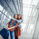 Girls having fun and happy when they met at the airport.Art proc - PhotoDune Item for Sale