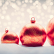 Christmas red balls on snow. Glitter lights - PhotoDune Item for Sale