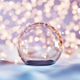 Christmas glass ball on snow. Glitter lights - PhotoDune Item for Sale
