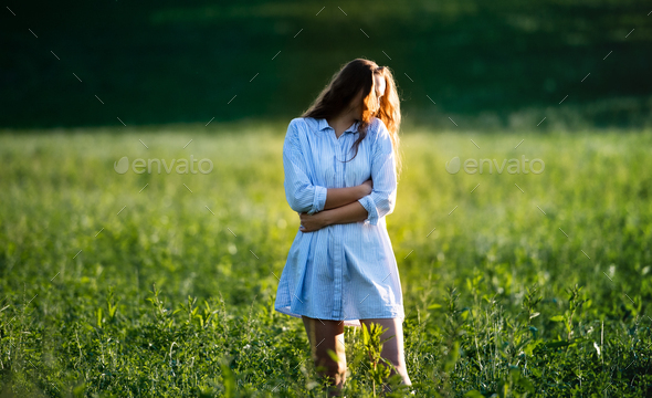 Portrait of young teenager girl outdoors in nature on meadow - Stock Photo - Images