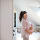 Portrait of happy pregnant woman indoors at home, touching her belly - PhotoDune Item for Sale
