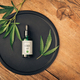 Cannabs medical product, CBD oil, with hemp leaves on black dish on wooden table - PhotoDune Item for Sale