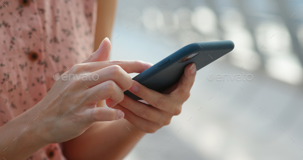 Close up of woman use of mobile phone at outdoor - Stock Photo - Images