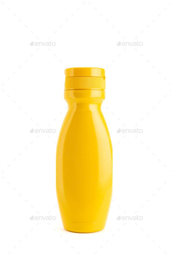 Mustard sauce bottle isolated on white background - Stock Photo - Images