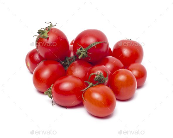 Plum tomatoes with leaves on white background - Stock Photo - Images
