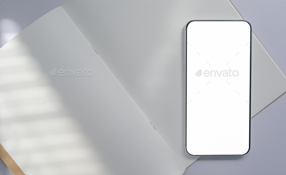Close-up shot of Smartphone placed on white book paper, communication concept. - Stock Photo - Images