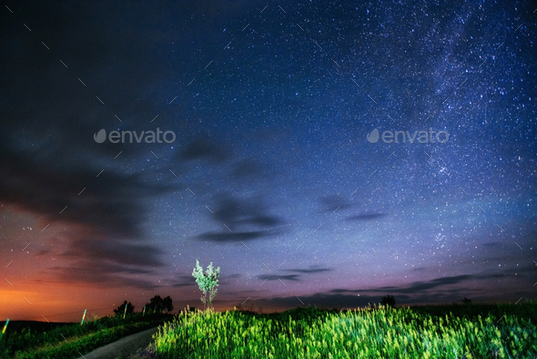 fantastic meteor shower and the snow-capped mountains - Stock Photo - Images
