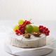 Camembert cheese with fruits, nuts and berries on a white background - PhotoDune Item for Sale