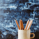 Pencils in a ceramic mug on a table with copy space. - PhotoDune Item for Sale