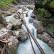 Beautiful mountain stream flowing through green mossy rocks - PhotoDune Item for Sale