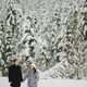 Portraits of happy family gently embracing and smiling in winter  forest - PhotoDune Item for Sale