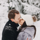 Stylish couple kissing in winter snowy mountains - PhotoDune Item for Sale