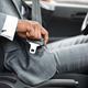 Black man in suit fasten seat belt in his car - PhotoDune Item for Sale