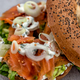 Salmon bagel with cream cheese, fresh herbs and veggies on a marble counter - PhotoDune Item for Sale