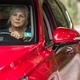 Old lady behind the wheel of a luxury red car - PhotoDune Item for Sale