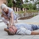 Helpful passerby checks the vital functions of the person who fainted on the street - PhotoDune Item for Sale