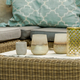 Lanterns, candles and vases on wicker coffee table in front of garden sofa - PhotoDune Item for Sale