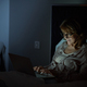 Woman using laptop in bed - PhotoDune Item for Sale