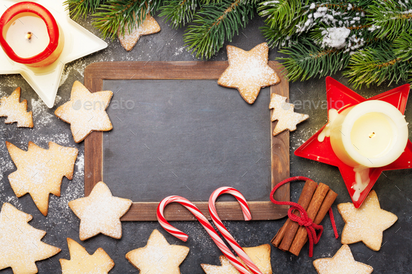 Christmas card with fir tree, cookies and candles - Stock Photo - Images