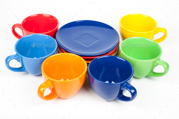 Multi-colored coffee cups and plates on white - Stock Photo - Images
