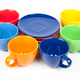 Multi-colored coffee cups and plates on white - PhotoDune Item for Sale
