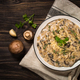 Champignons in cream sauce at white table - PhotoDune Item for Sale