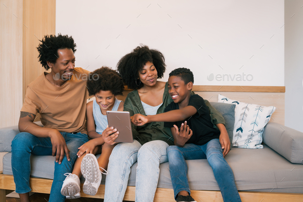 Family taking selfie together with tablet at home. - Stock Photo - Images
