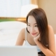 Portrait beautiful young asian woman use computer laptop on bed - PhotoDune Item for Sale