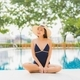 Portrait beautiful young asian woman relax smile around outdoor swimming pool in hotel resort - PhotoDune Item for Sale