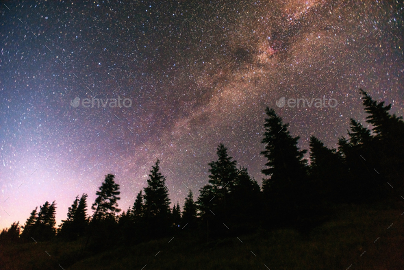 fantastic winter meteor shower and the snow-capped mountains - Stock Photo - Images