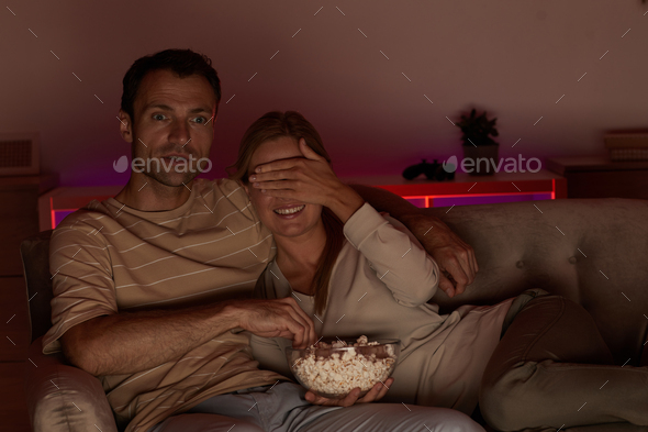 Watching scary movie at home - Stock Photo - Images