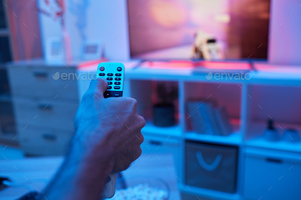 Man watching TV - Stock Photo - Images