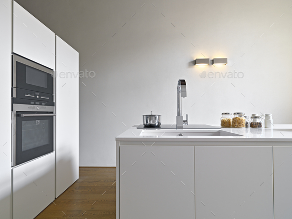 Interiors of a Modern Kitchen with Island Kitchen - Stock Photo - Images
