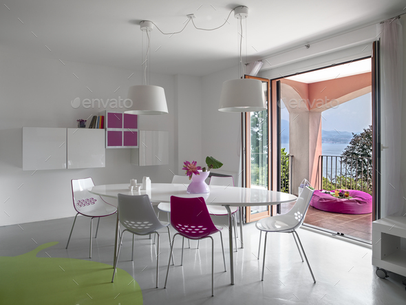 Interiors of a Modern Living Room with Dining Table - Stock Photo - Images