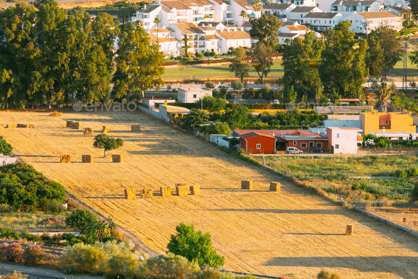 Andalusia region, Spain. Elevated View Of Rural Landscape Field With Hay Bales Rolls - Stock Photo - Images