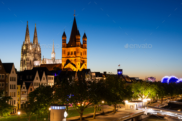 Great Saint Martin Church and Cologne Cathedral at night - Stock Photo - Images
