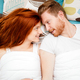 Red haired couple smiling in bed - PhotoDune Item for Sale