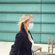 Mature Businesswoman Wearing PPE Face Mask Walking Outdoors In Street During Health Pandemic - PhotoDune Item for Sale