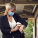Businesswoman At Railway Station Checking Smart watch Wearing PPE Face Mask During Health Pandemic - PhotoDune Item for Sale