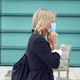 Mature Businesswoman Putting On PPE Face Mask Walking Outdoors In Street During Health Pandemic - PhotoDune Item for Sale