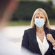 Mature Businesswoman Wearing PPE Face Mask Meeting Colleague In Street During Health Pandemic - PhotoDune Item for Sale