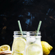Iced lemonade with juice in the bottles, dark background, selective focus - PhotoDune Item for Sale