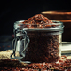 Crude red rice in a glass jar, black background, selective focus - PhotoDune Item for Sale
